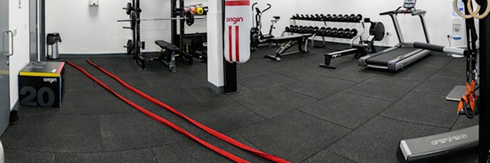 rubber gym flooring tiles in an exercise room