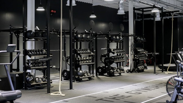 an exercise room with gymshark free weights