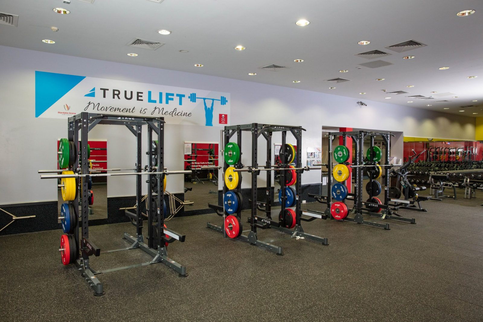 weight racks on a gym floor