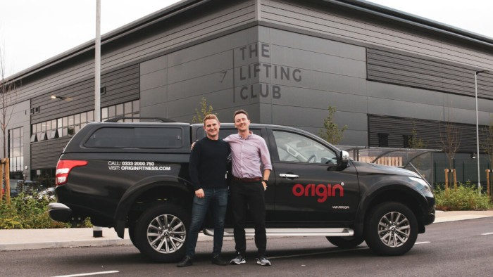 a photo of the origin fitness team outside gymshark lifting club