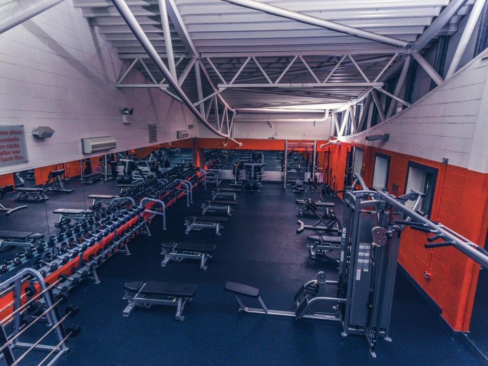 weight lifting exercise area with benches and lose weights